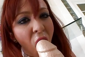 lascivious redhead milf playing with huge sex toy