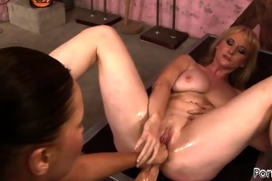 hawt milf acquires a lesbo fist in her taut anus