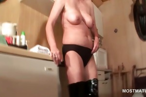 older in latex boots finger fucks her muff in bed