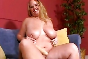 large breasted golden-haired milf masturbates on