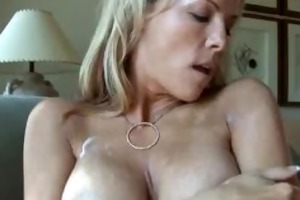 blonde mother i massages her giant breast with a