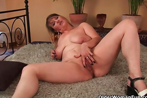 large boobed mama enjoys his fist and dick in her