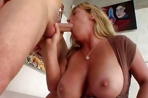 heavy chested tanned blond momma sucks rigid dong