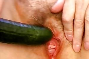 granny masturbate with cucumber in kitchen