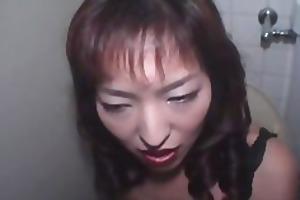 mature oriental hottie opens her throat wide for