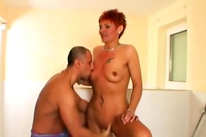 older sweetheart showering her shaved pussy
