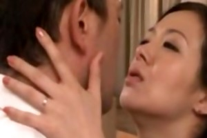 older oriental milf giving a kiss with voyeur