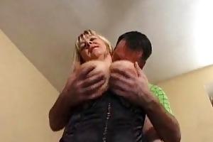 breasty older model in hose receives drilled