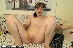 older bitch plays with her snatch