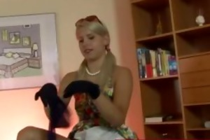 chic lady wearing handgloves putting on her nylons