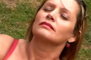 older with large boobs satisfying herself in the