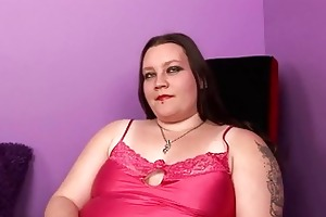 pale fat momma with tattooes and piercings sticks