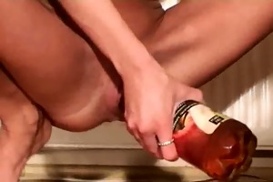 skinny slut fucking biggest bottles in her twat