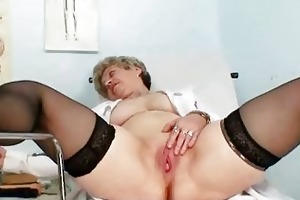 breasty granny in uniform stretching her aged cunt