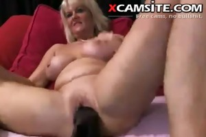 older bitch makes use of her massive sex-toy