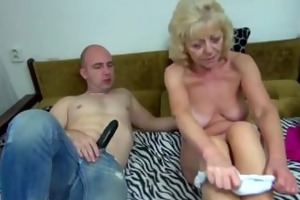 old corpulent granny in the bed has sex with
