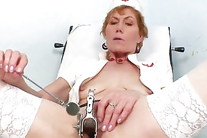 old mama self exam on gynochair with speculum