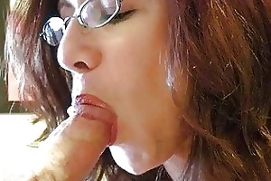 redhead momma with giant tits and glasses gives