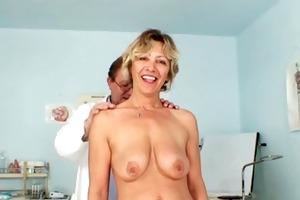 vanda has her lewd mature pussy opened by speculum