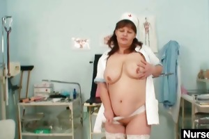 large scoops mature lady wears nurse uniform and