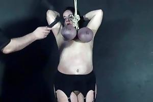 tit hanging punishment of older roped slavegirl