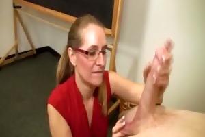 mature blonde sucks a large boner